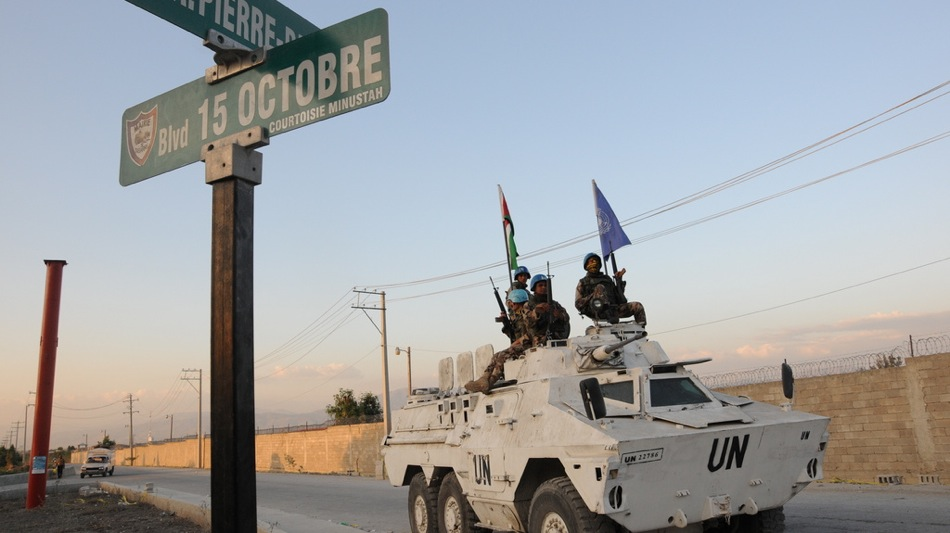 UN peacekeepers guard the entrance to Logbase in Port-au-Prince