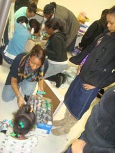 Samira Louis packs boxes to aid Haiti's earthquake victims.