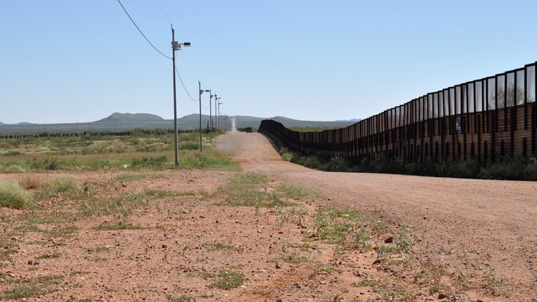 Fence along the U.S.-Mexico border in Necos, Arizona.