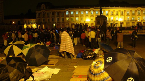 Displaced peasants protest before Colombia's Congress.