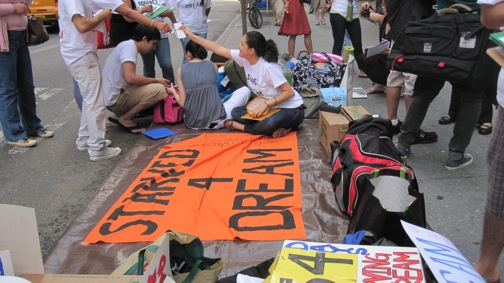 Students prepare to begin a hunger strike outside Senator Charles Schumer's office.