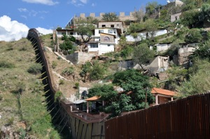 The wall in Nogales that divides the United States from Mexico. The city of Heroica Nogales (Sonora, Mexico) can be seen across the barrier.