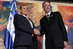 Honduran President Porfirio Lobo shaking hands with Guatemalan President Álvaro Colom at a meeting on May 13.