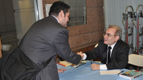 "Claudio Remeseira, editor of ""Hispanic New York: A Sourcebook,"" signed books at the launch last week."
