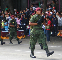 A Mexican soldier marches in a parade.