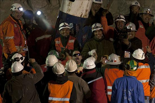 Chilean workers at the site where the first miner was rescued.