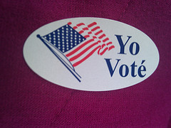 "A Spanish-language sticker distributed at polling sites reading ""I voted."""