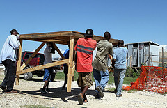 British and Haitian Red Cross workers establish an observation center to monitor and treat cholera cases.