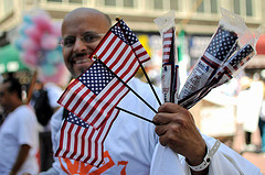 A man sells flags at an immigration rally in Los Angeles.