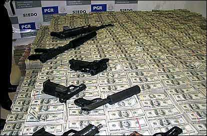 Money and weapons seized from Mexican drug cartels.