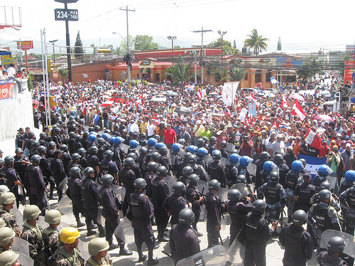 Honduran police square off against protestors after the 2009 coup.