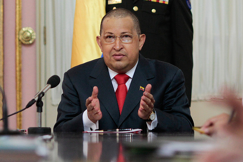Venezuelan President Hugo Chávez wil his newly shaved head.