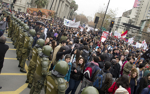 Police and student protesters in Chile in June.