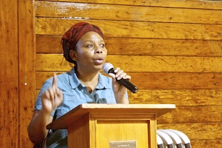 Carla Garcia addresses Garifuna during a community meeting at the Bronx Evangelical Church
