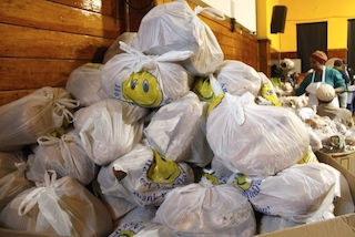 Shopping bags of bread donated to the Garifuna at the Bronx Evangelical Church.