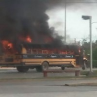 A burning bus used as a blockade Saturday in the Mexican city of Reynosa. (YouTube, screenshot)