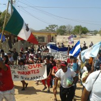 Viacrucis participants march through Chahuites, Mexico. (Photo by author)