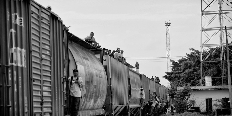 """Migrants aboard the train known as """"The Beast"""" in Southern Mexico. Photo by Peter Haden."""