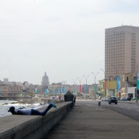 Banners for the 12th Edition of Cuba's Biennial line the streetlights of the Malecón.