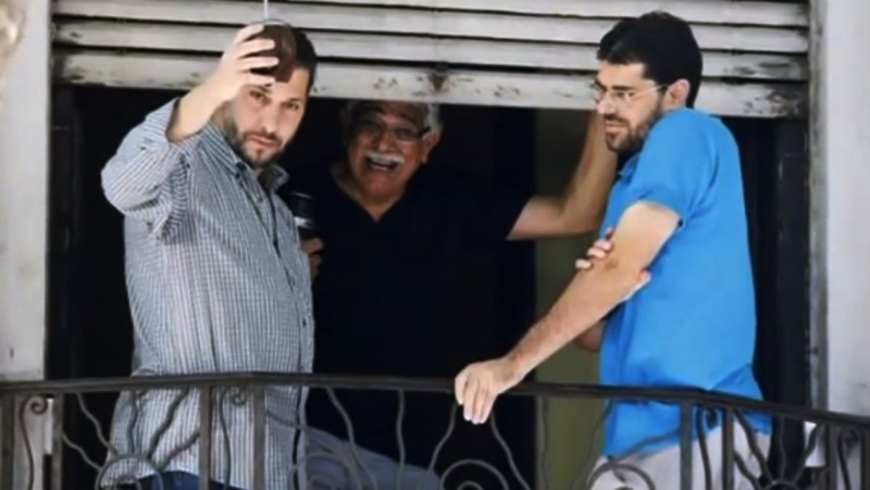 Former Guantánamo detainees Omar Abdelahdi, originally from Syria, and Adel bin Muhammad, from Tunisia, greeted the media from the balcony of their Montevideo house, following their arrival in December. (Reuters, Screenshot)