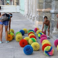 "Passerbys test out Carlos Montes de Oca's installation ""Limpiando un rincón del alma"" (Cleaning a corner of the soul)."