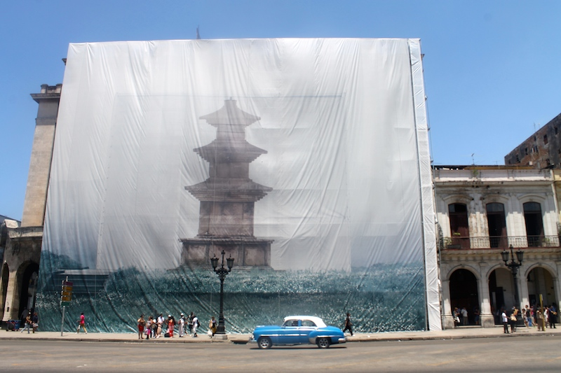 A banner by Han Sungpil located across from the Capital building in Old Havana.
