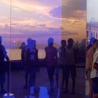 """People enter """"Proyecto Reality- Cubo Azul"""" (Reality Project- Blue Cube) by Rachel Valdes."""