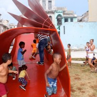 "Kids race down the slide of ""Parto a la libertad"" (Birth to liberty) by Liudmila López ."