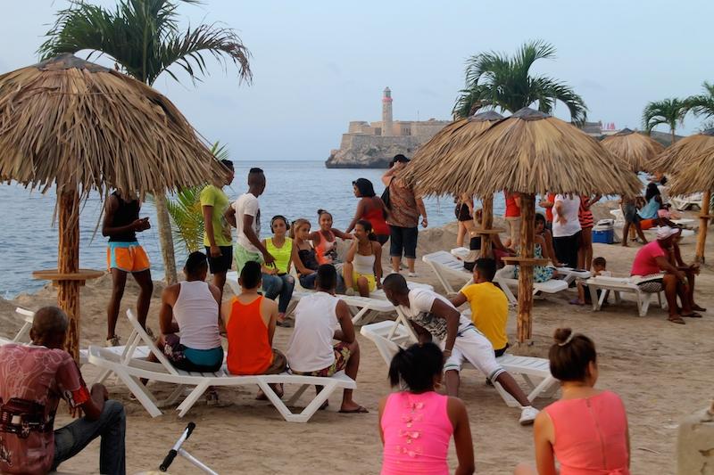 "People enjoy the ""beach"" at ""Resaca"" (Hangover)  by Arles del Río."