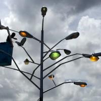 "A worker finishes installing ""Árbol de Luz"" (Tree of Light) by Rafael Villares."