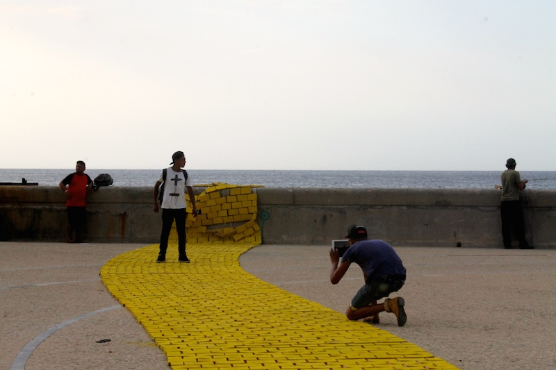 "Teens snap photos on ""Lemon Way"" by Carlos Nicanor."