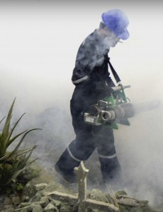 A worker fumigates in an effort to kill mosquitoes that spread the Zika virus. (Image: Youtube)