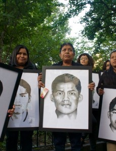 Demonstrators in New York City hold portraits of the 43 students who went missing in Iguala, Mexico.