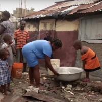 Haitians clean up after Hurricane Matthew.