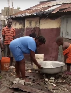 Haitians clean up after Hurricane Matthew.